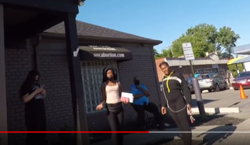 Woman in Line Threatens Christian with Throwing Literal Stones at Him